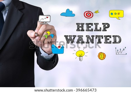 HELP WANTED CONCEPT Businessman drawing Landing Page on blurred abstract background - stock photo