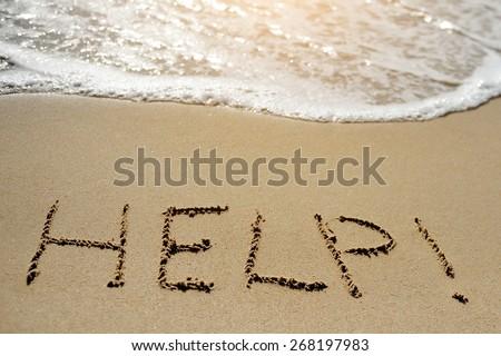 help written on sand beach near sea - stock photo