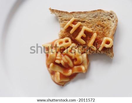 help written on toast with alphabetti spaghetti - stock photo
