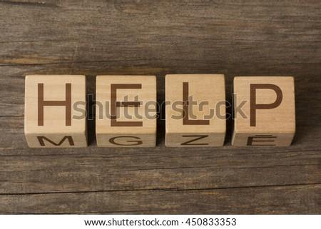HELP written on wooden cubes - stock photo
