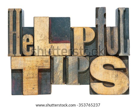 helpful tips phrase made from mixed wooden letterpress type isolated on white - stock photo