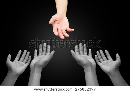 helping hand and hands praying on  black background , helping hand concept. - stock photo