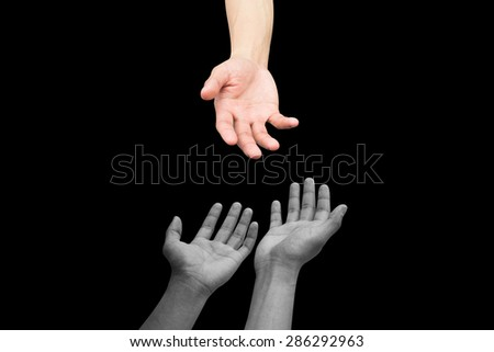 helping hand and hands praying on black background,helping hand concept.pray for paris conception:strong together conceptual:assistance and support.kindness and tenderness conceptual. - stock photo