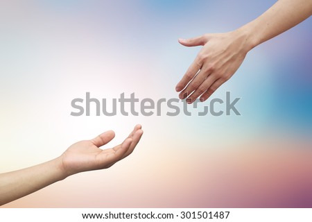 helping hand and hands praying on blurred beautiful nature sunshine sky background.supporting/assistance concept.god giving/blessing the power to human:victim of holocaust conceptual:spiritual ideal - stock photo