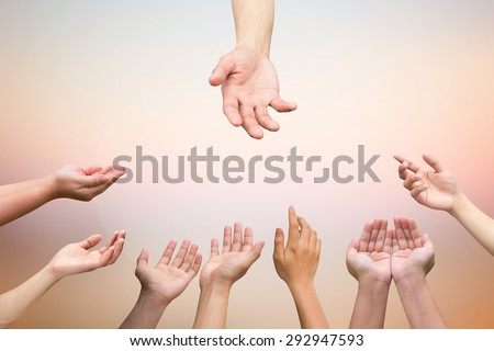 helping hand and hands praying on blurred twilight sky background , helping hand concept. - stock photo