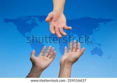 helping hand and hands praying over blur map of the world on blurred blue sky backgrounds. helping hand concept.international assistance concept.business concept.peaceful concept.help economics crisis - stock photo
