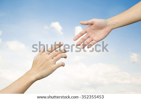 helping hand and hands praying.supporting of humanity conceptual.giving strength power:friends and family relationship,encouragement:abstract healing and assistance ideal in vintage tone color concept - stock photo