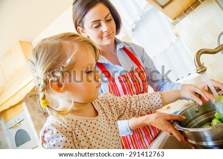 Helping hand given from little blond girl. - stock photo