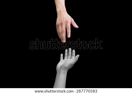 helping/supporting hand and hands praying on black background:rescue humanity concept.assistance conceptual. - stock photo