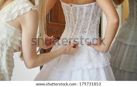 Helping the bride to put her - stock photo