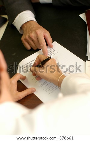 Helping to fill out the forms - stock photo