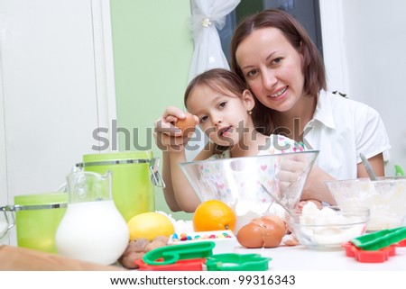 helping to mother in the kitchen - stock photo