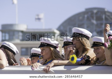 HELSINGBORG, SWEDEN - JUN 05: Graduates from different schools take part in a celebration parade through the town centre on June 05, 2015 in Helsingborg, Sweden. - stock photo