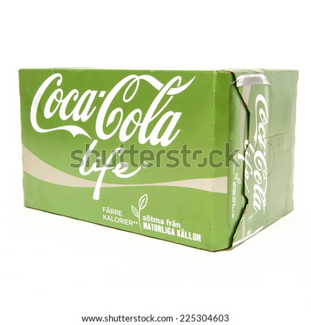HELSINGBORG, SWEDEN - October 20th 2014: 6 pack of Coca-Cola life cans on White Background. Coca-Cola is a carbonated soft drink sold in shops, restaurants, and vending machines around the globe. - stock photo