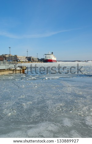 Helsinki beautiful ice covered port on the Baltic sea in spring - stock photo