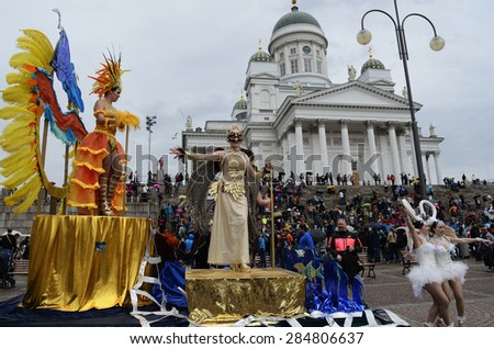Helsinki, Finland  June 6, 2015: Traditional summer samba carnival. Teams from different cities in Finland took part in the carnival. June 6 participants parading down the center of Helsinki. - stock photo