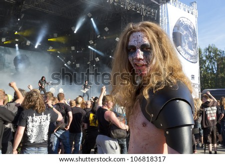 HELSINKI, FINLAND - JUNE 29: Unidentified Fans at gig of american heavy metal band Trivium June 29, 2012 at 15th annual Tuska Open Air Metal Festival in Suvilahti, in Helsinki, Finland. - stock photo