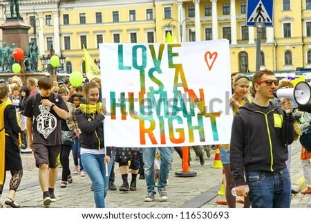 HELSINKI, FINLAND - JUNE 30: Unidentified people take part in the annual Helsinki Pride gay parade in Helsinki, Finland on June 30, 2012. - stock photo