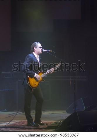 HELSINKI, FINLAND - MARCH 13: American blues rock guitarist and singer Joe Bonamassa performs at Finlandia Hall on March 13, 2012 in Helsinki, Finland. - stock photo