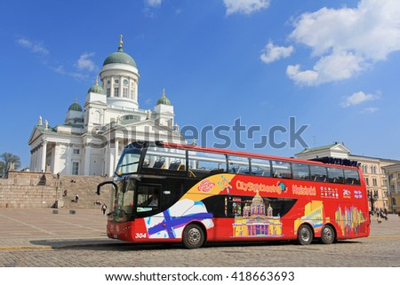 HELSINKI, FINLAND - MAY 10, 2016: Red double-decker Hop On Hop Off sightseeing bus waits for passengers at the Senate Square and Helsinki Cathedral.  - stock photo