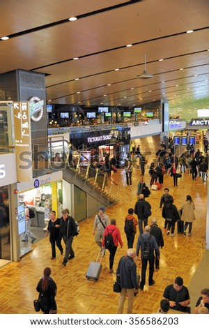 HELSINKI, FINLAND - NOVEMBER 16:Travelers and shops at Helsinki International Airport. This is Helsinki International Airport. November 16, 2015 Helsinki, Finland - stock photo