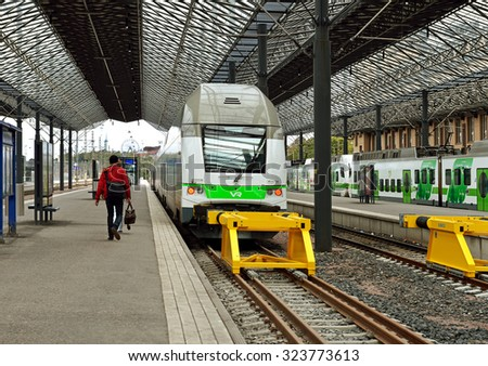 HELSINKI, FINLAND - SEPT 26, 2015:Central railway station serves as point of origin for all trains in local VR commuter rail network, as well as for large proportion of long-distance trains - stock photo