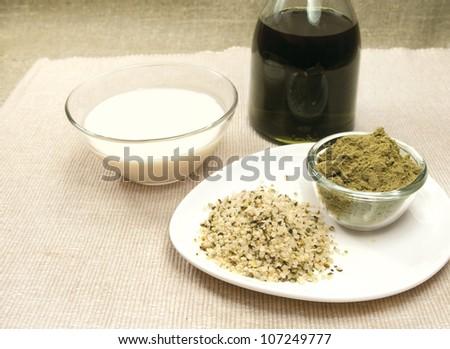hemp products: oil, milk, powder, seeds - stock photo