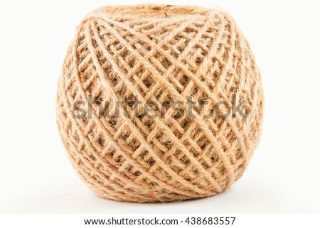hemp rope roll white background - stock photo