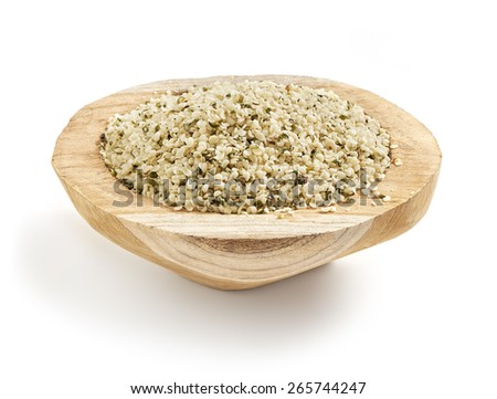 hemp seed served in a wooden bowl with a soft shadow - stock photo