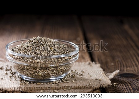 Hemp Seeds (close-up shot) on an old wooden table - stock photo