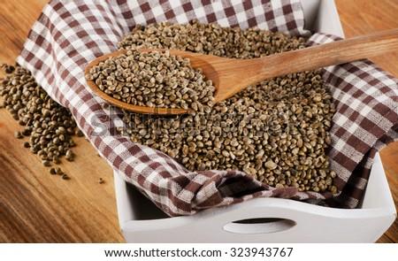 Hemp seeds on  wooden background. Selective focus - stock photo