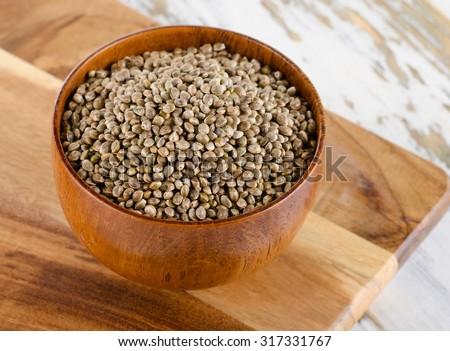 Hemp seeds on  wooden table. Selective focus - stock photo
