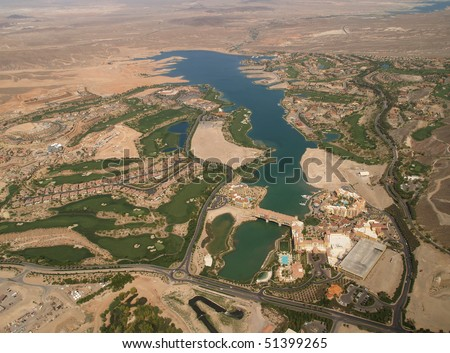 HENDERSON, NV. - APRIL 09: Aerial view of Lake Las Vegas, a man made 320 acre lake also features world-class resorts & is home to Celine Dion and many others. Taken on 4/9/07 over Clark County. - stock photo