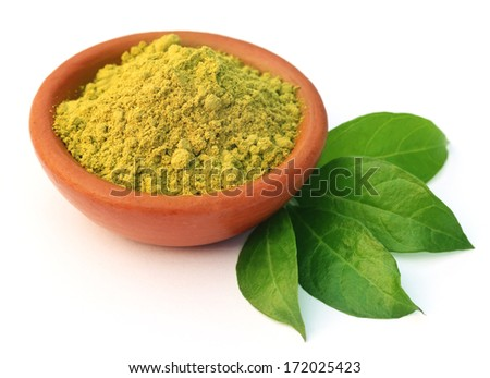 Henna leaves with powder over white background - stock photo