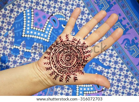 Henna tattoo on the arm - stock photo