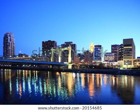 Hennepin bridge with downtown Minneapolis - stock photo