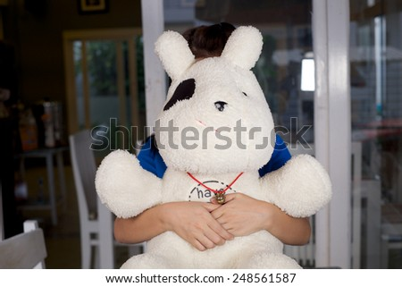 her hold baby doll - stock photo