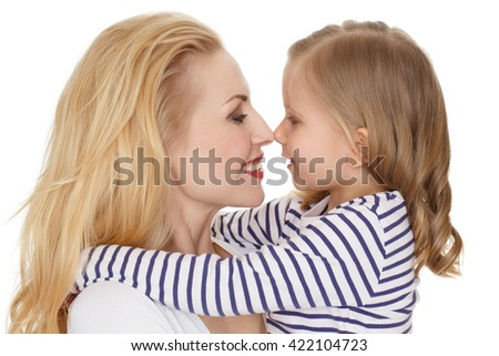 Her little big world. Close up shot of a charming mother rubbing noses with her child smiling happily on white background. - stock photo