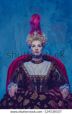 Her royal highness sitting on throne - stock photo