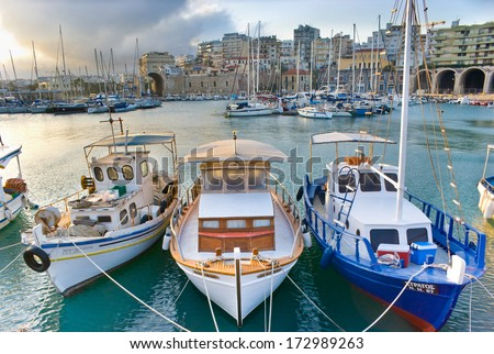 HERAKLION, GREECE - OCTOBER 13, 2013: These boats came back after early morning fishing and have some rest in the Old Venetian Harbour, on October 13 in Heraklion, Crete, Greece. - stock photo