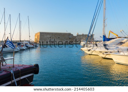 Heraklion harbour with venetian fort and boats, Crete, Greece - stock photo