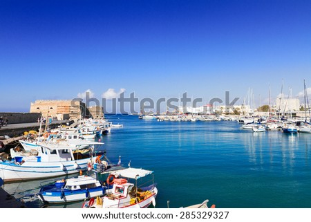 Heraklion old venetian harbour with colorful small boats, Crete, Greece - stock photo