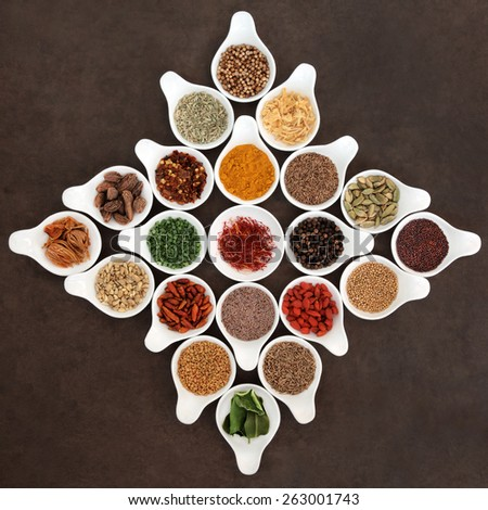 Herb and spice seasoning selection in porcelain bowls. - stock photo