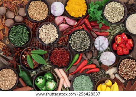Herb and spice selection over old oak wood background. - stock photo