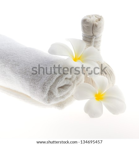 Herb ball beside white towel decorate with white flower against white background - stock photo