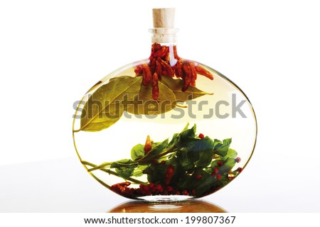 Herb-flavored oil - stock photo