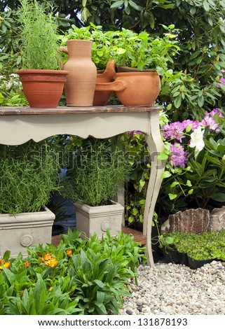 Herb garden at  patio or home yard in with pots of plants and herbs. - stock photo