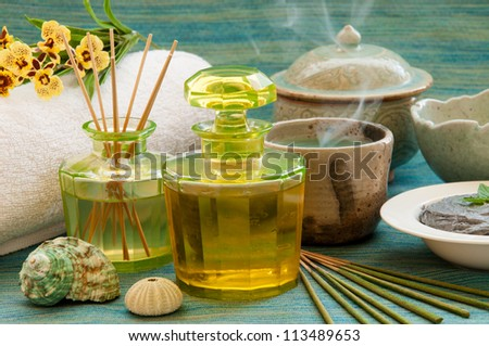 Herbal and oil treatment equipment in relaxing spa scene. - stock photo