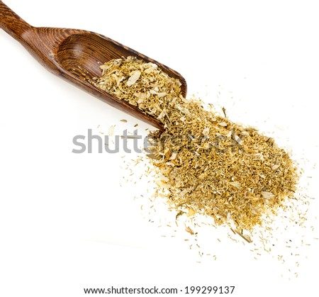 Herbal chamomile tea in wooden spoon isolated on white background - stock photo