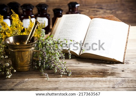 Herbal medicine and book - stock photo